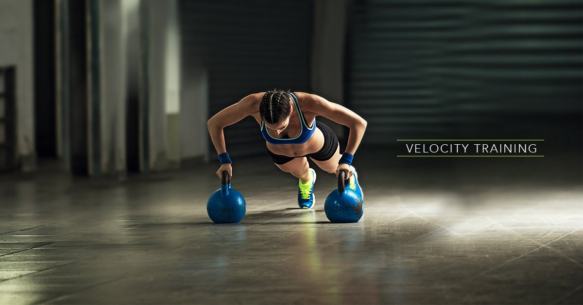 A woman doing velocity training at home.