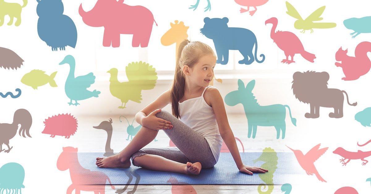 Young girl doing kids' exercises on a yoga mat